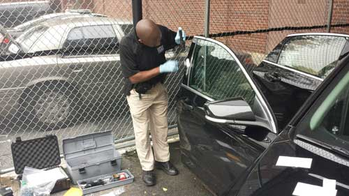Police Investigator Inspecting a Car