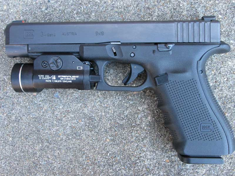Glock 34 with tactical light (primary duty weapon)