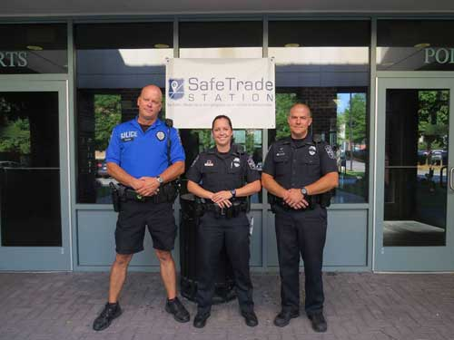 Officers Posing by SafeTrade Station