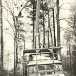 A black and white photo of a Power and Water truck with a pole attached to the top of it