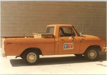 An older orange Power and Water truck