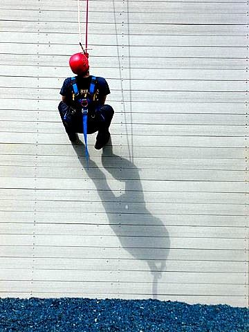 Firefighter Rappells Down a Wall